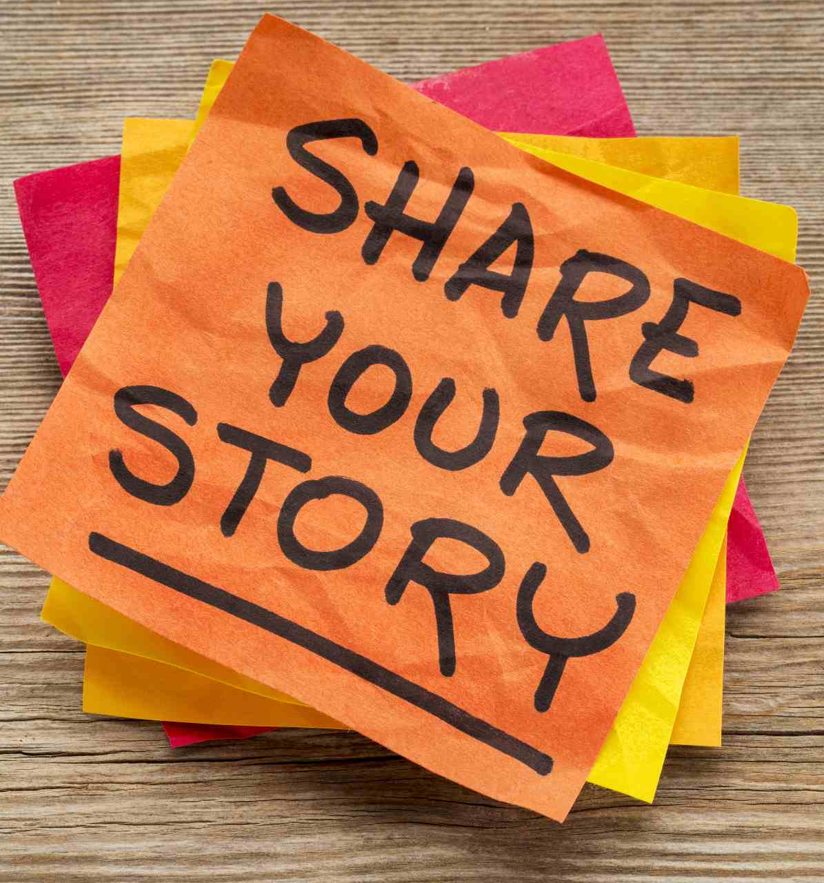 post it note with share your story for engaging content